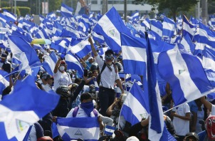 Demonstrators protesting government repression wave Nicaraguan flags in Managua, Nicaragua, Wednesday, May 9, 2018. Nicaraguans took the the streets in one of the largest protest marches so far, against the government of President Daniel Ortega. (AP Photo/Alfredo Zuniga)